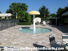 For swimmers not yet accustomed to the deep end, Boynton Beach's Greystone community provides a fun wading pool adjacent to the main swimming pool.
